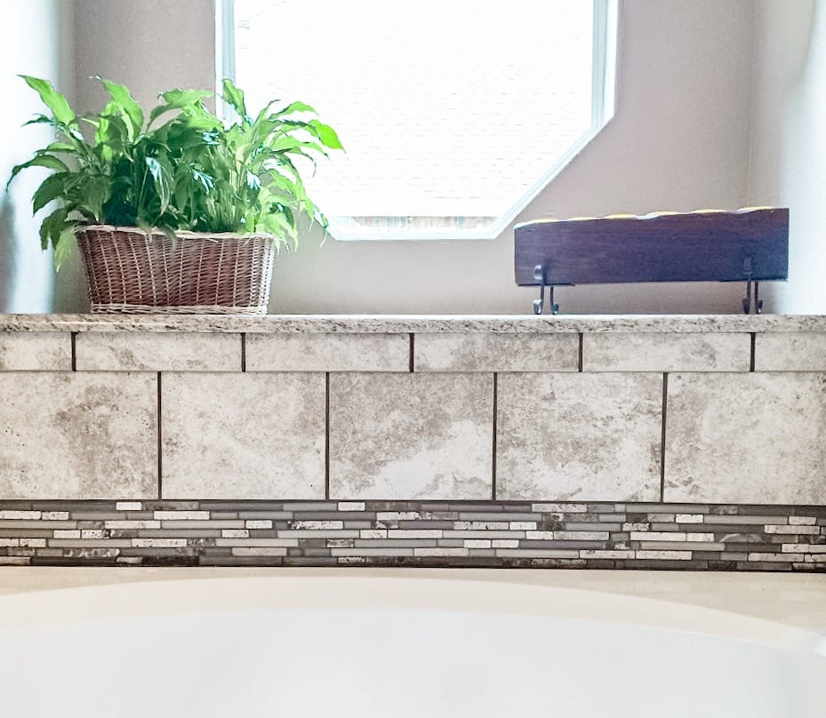 bathtub grey tile backsplash