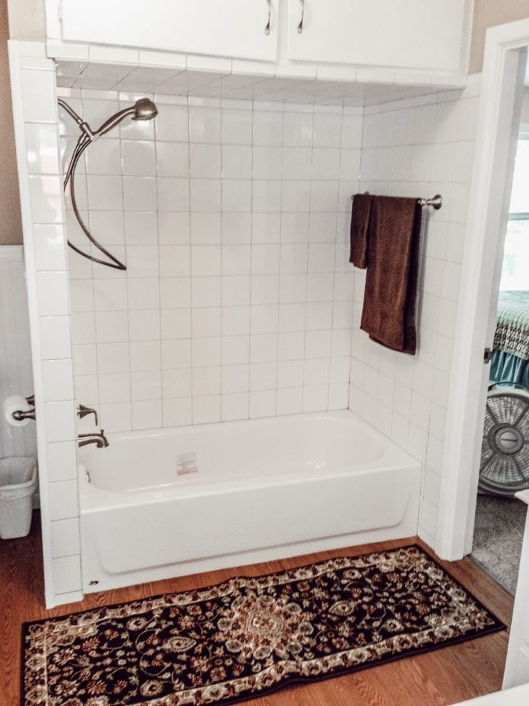 shower remodel with rug and towel