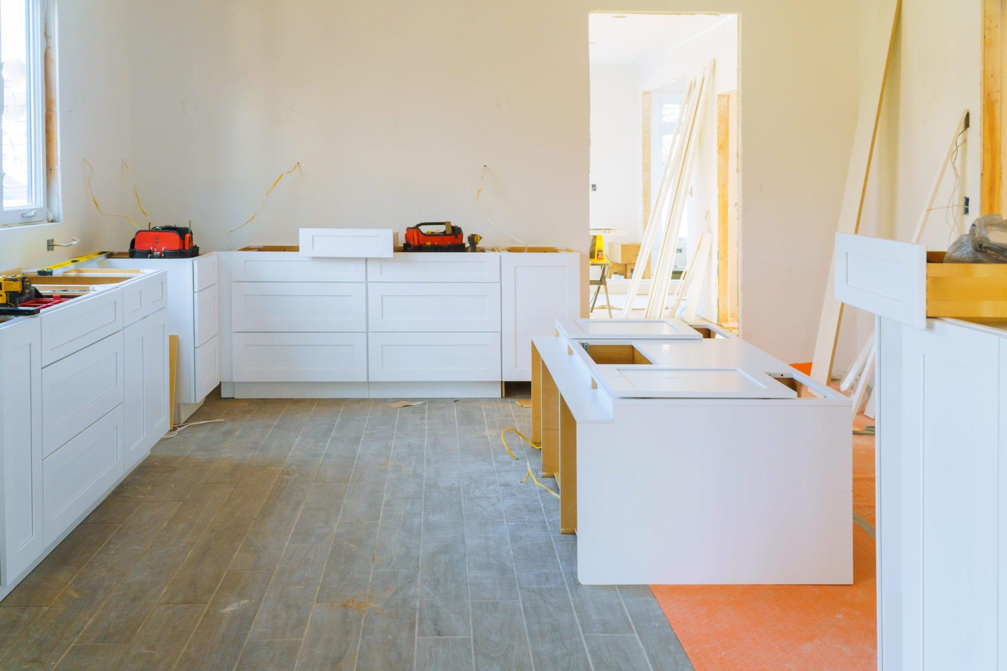 Installation modern kitchen cabinet closeup of furniture details.