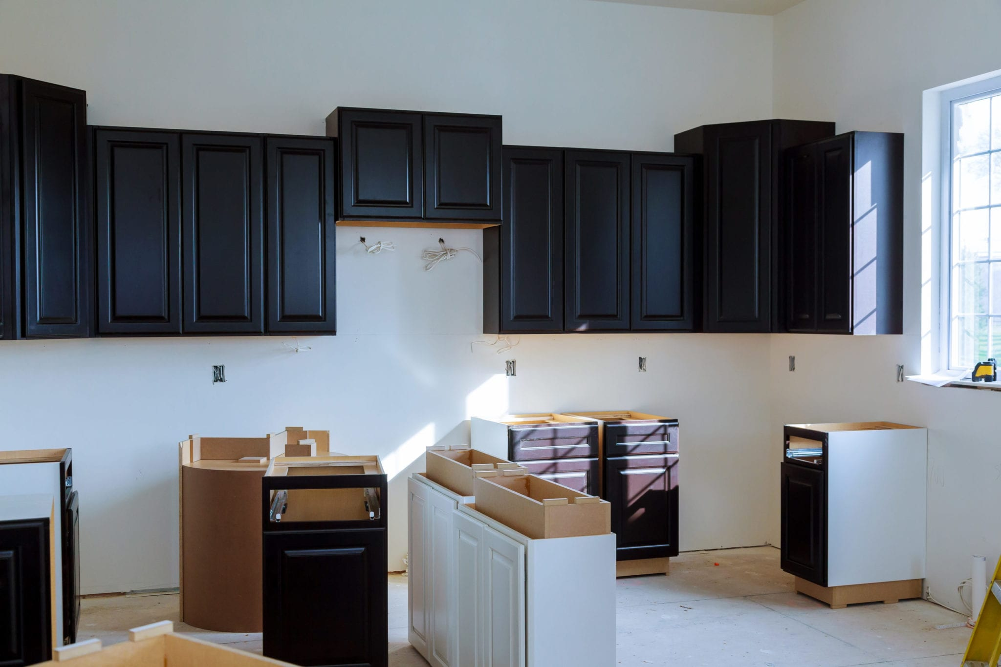Kitchen cabinets installation Blind corner cabinet, island drawers and counter cabinets installed